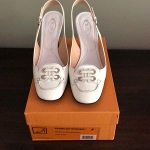 100% Authentic White Patent Tod's sling-backs.